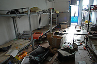 "Ransacked and desterted dormitories in Dingfu Factory in Houjie Town, Donguan, China.  A sign outside the factory that made shoes for Zara and Nine West amongst others, reads that the ""Donguan People's Court have closed the factory"" .  As the economy changes and Chinese labour gets more expensive, factories are cosing leaving ghost towns behind them.<br /> <br /> MUST CREDIT PHOTO BY RICHARD JONES/SINOPIX"