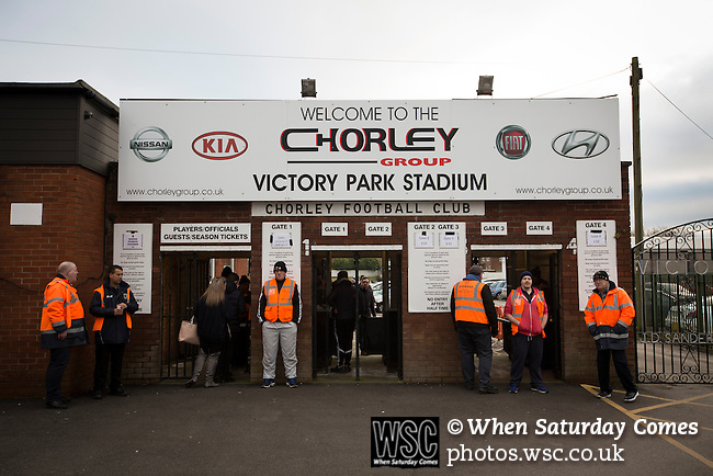 Chorley 2 Altrincham 0, 21/01/2017. Victory Park, National League North. Stewards stand on duty at the entrance to Victory Park, before Chorley played Altrincham in a Vanarama National League North fixture. Chorley were founded in 1883 and moved into their present ground in 1920. The match was won by the home team by 2-0, watched by an above-average attendance of 1127. Photo by Colin McPherson.