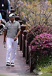 SUZHOU, CHINA - APRIL 17:  Thongchai Jaidee of Thailand crosses a bridge to the 2nd green during the Round Three of the Volvo China Open on April 17, 2010 in Suzhou, China.  Photo by Victor Fraile / The Power of Sport Images