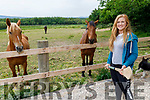 Laura Collins standing in her equestrian centre on Sunday morning