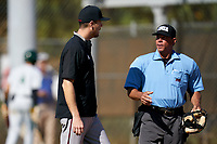 Omaha Mavericks head coach Evan Porter argues a call with the home plate umpire during a game against the Dartmouth Big Green on February 23, 2020 at North Charlotte Regional Park in Port Charlotte, Florida.  Dartmouth defeated Omaha 8-1.  (Mike Janes/Four Seam Images)