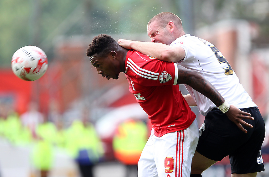 Nottingham Forest's Britt Assombalonga battles with  Derby County's Jake Buxton<br /> <br /> Photographer Mick Walker/CameraSport<br /> <br /> Football - The Football League Sky Bet Championship - Nottingham Forest v Derby County - Sunday 14th September 2014 - The City Ground - Nottingham<br /> <br /> &copy; CameraSport - 43 Linden Ave. Countesthorpe. Leicester. England. LE8 5PG - Tel: +44 (0) 116 277 4147 - admin@camerasport.com - www.camerasport.com