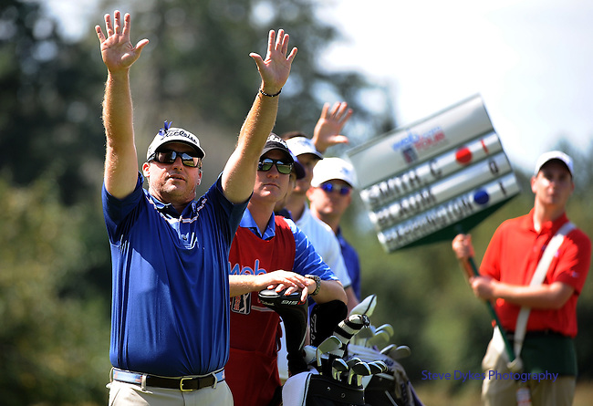 NORTH PLAINS, OR - AUGUST 21: Chris Smith tries to get the attention of a group cutting across the fairway as the try to tee of of the third hole during the first round of the WinCo Foods Portland Open presented by Kraft on August 21, 2014 in North Plains, Oregon.  (Photo by Steve Dykes/Getty Images) *** Local Caption *** Chris Smith