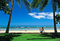 Relaxing in the shade of swaying palm tress on Waikiki Beach with a spectacular view of Hawaii's inviting blue waters. What a way to spend the day !!