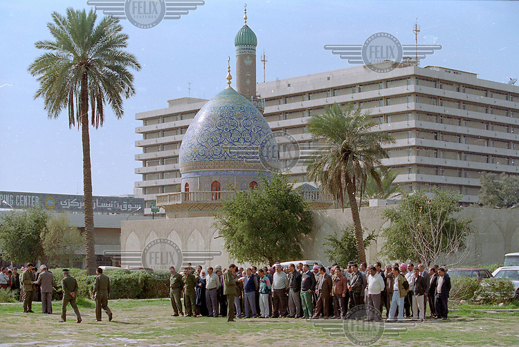 Iraqi men undergo military basic training by the Al Shawy mosque, in preparation for a feared attack. The crisis over weapons inspections brought the Gulf to the brink of war, but U.N. Secretary-General Kofi Annan and Iraq signed a deal in 1998, which turned out to postpone the conflict.