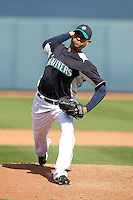 Manny DelCarmen #31 of the Seattle Mariners pitches in a spring training game against the San Diego Padres at Peoria Stadium on February 27, 2011  in Peoria, Arizona.  .Photo by:  Bill Mitchell/Four Seam Images.