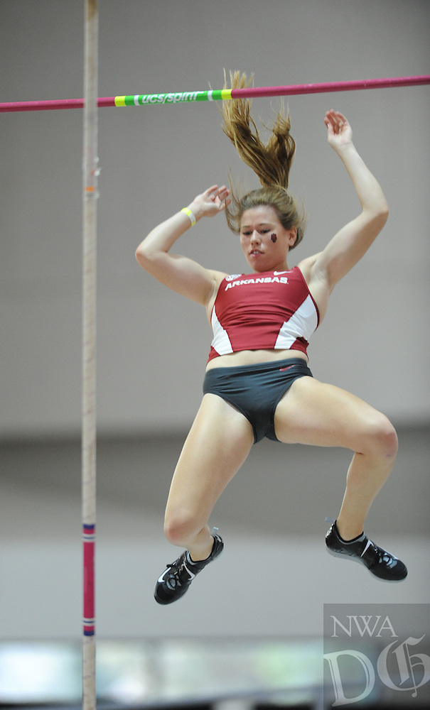 NWA Democrat-Gazette/ANDY SHUPE<br />Rylee Robinson of Arkansas clears the bar Friday, Jan. 27, 2017, during the pole vault competition in the Razorback Invitational in the Randal Tyson Track Center in Fayetteville. Visit nwadg.com/photos to see more photographs from the meet.