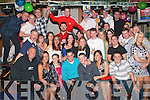 5590-5594.---------.Key to the Door.---------------.Oige Cox(seated centre)from Manor,Tralee celebrated his 21st last Saturday night with a wild party in the Huddle bar,Strand Rd Tralee,attended by many family&friends.
