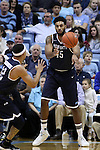 28 December 2016: Monmouth's Chris Brady (45) throws the ball in to Justin Robinson (left). The University of North Carolina Tar Heels hosted the Monmouth University Hawks at the Dean E. Smith Center in Chapel Hill, North Carolina in a 2016-17 NCAA Division I Men's Basketball game. UNC won the game 102-74.