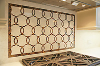This custom kitchen features a half scale Seine mosaic backsplash shown in waterjet-cut Emperador Dark and Botticino from the Silk Road Collection by Sara Baldwin for New Ravenna. <br />