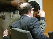 Defense attorney Peter Greenspun comforts convicted sniper John Allen Muhammad during the penalty phase of his trial in courtroom 10 at the Virginia Beach Circuit Court in Virginia Beach, Virginia on Thursday, November 20, 2003.  Closing arguments in the case were delivered Thursday evening.<br /> Credit: Lawrence Jackson - Pool via CNP
