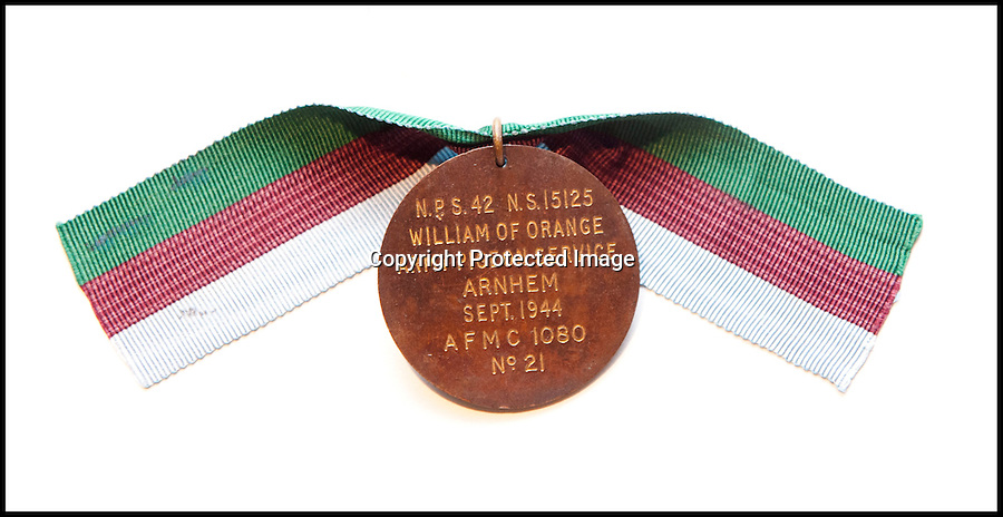 BNPS.co.uk (01202 558833)<br /> PIc: LauraJones/BNPS<br /> <br /> The Dickin Medal awarded to the pigeon. <br /> <br /> This is the humble carrier pigeon which brought back the first news that the audacious Battle of Arnhem during World War Two was not going to plan.<br /> <br /> The desperate British troops resorted to using the bird to send an SOS message three days into the daring operation behind enemy lines after their radios had failed.<br /> <br /> The note attached to the pigeon stated the Paratroopers at Arnhem Bridge were cut off and in desperate need of air support to counter the superior German forces.<br /> <br /> Under fire and in almost farcical scenes, two soldiers tried to launch the bird, nicknamed William of Orange, off the bridge but it refused to budge.<br /> <br /> It was only when one of them fired his Sten gun into the air the pigeon was spooked and flew off into the night.<br /> <br /> Incredibly, he took just four hours and 25 minutes to fly the 260 miles back to its loft in Knutsford, Cheshire, with the message that was then relayed to the authorities.