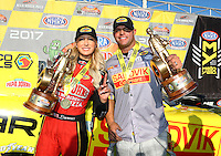 Feb 26, 2017; Chandler, AZ, USA; NHRA top fuel driver Leah Pritchett (left) and funny car driver Matt Hagan celebrate after winning the Arizona Nationals at Wild Horse Pass Motorsports Park. Mandatory Credit: Mark J. Rebilas-USA TODAY Sports