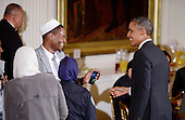 United States President Barack Obama greets guests during an Iftar dinner celebrating Ramadan in the East Room of the White House in Washington, DC, Monday, June 22, 2015.<br /> Credit: Olivier Douliery / Pool via CNP