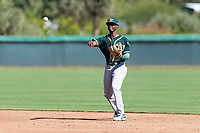 Oakland Athletics second baseman Marcos Brito (5) throws to first base during an Instructional League game against the Los Angeles Dodgers at Camelback Ranch on September 27, 2018 in Glendale, Arizona. (Zachary Lucy/Four Seam Images)