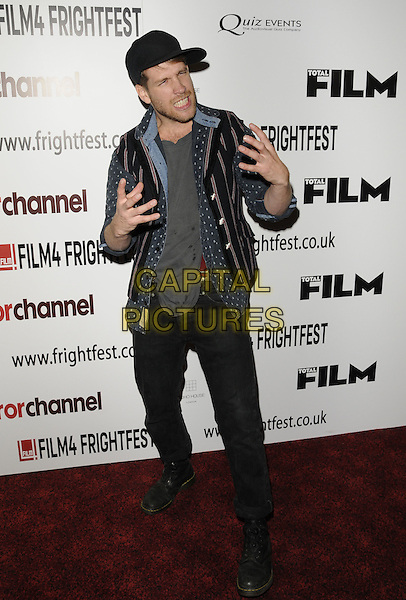 "director RYAN ANDREWS.""Elfie Hopkins"" world premiere arrivals,  Film4 Frightfest Day 3, Empire cinema, Leicester Square, London, England..August 27th, 2011.full length black jeans denim grey gray shirt hat hands funny.CAP/CAN.©Can Nguyen/Capital Pictures."