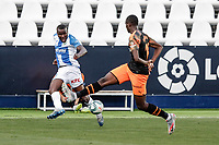12th July 2020; Estadio Municipal de Butarque, Madrid, Spain; La Liga Football, Club Deportivo Leganes versus Valencia; Mouctar Diakhaby (Valencia CF) attempts to block the shot on goal