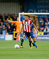 Brentford's Nico Yennaris on the ball during the Carabao Cup match between AFC Wimbledon and Brentford at the Cherry Red Records Stadium, Kingston, England on 8 August 2017. Photo by Carlton Myrie.