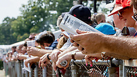 SARATOGA SPRINGS, NY - AUGUST 25: Fans lean over the rail to get a better view of the days races on Travers Stakes Day at Saratoga Race Course on August 25, 2018 in Saratoga Springs, New York. (Photo by Sue Kawczynski/Eclipse Sportswire/Getty Images)