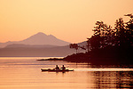 Sea kayakers, San Juan Islands, Mount Baker, Pacific Northwest, Washington State, Sunrise, Haro Strait, foreground: Gulf Islands British Columbia, Canada