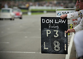 10th September 2017, Goodwood Estate, Chichester, England; Goodwood Revival Race Meeting; A member of the Don Law racing team holds up a race timing board
