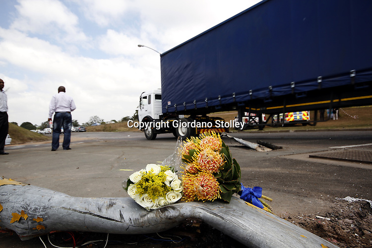 DURBAN - 6 September 2013 - A boquet of flowers placed by an unknown mourner on flattened traffic lights at the same intersection where 22 people were killed when a lorry, similar to that in the picture, crashed into four minibus taxis and a car. It had initially been reported that as many as 27 people were killed, but it was officialy confirmed on Friday that 22 were killed with scores more injured. Picture: Allied Picture Press/APP