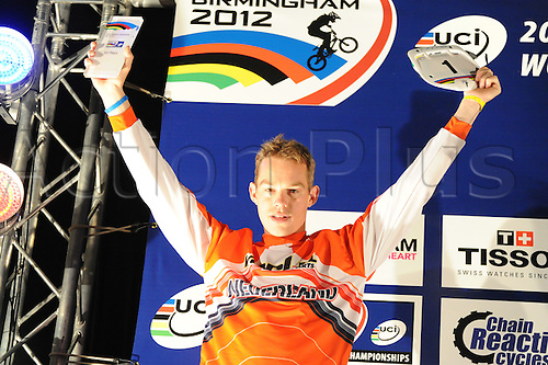 05.27.2012. England, Birmingham, National Indoor Arena. UCI BMX World Championships. Podium trio for the Cruisers Men 25 - 29 Finals at the NIA. ..Niels Verrijt (Nederland) 1st......