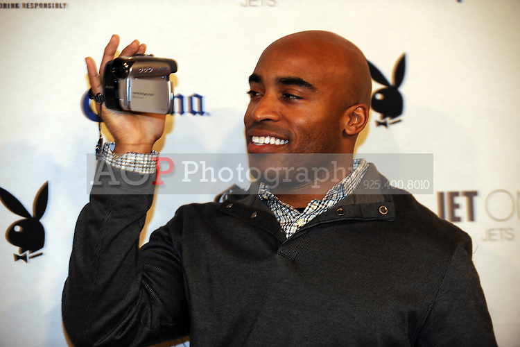 "Tiki Barber videotapes the media at Playboy's ninth annual ""Super Saturday Night""  party in at Playboy's Desert Oasis and Resort in Chandler, Arizona Saturday February 2, 2008.   (Photo by Alan Greth)"