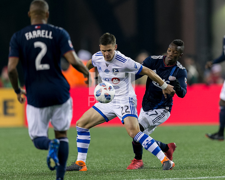Foxborough, Massachusetts - April 6, 2018: First half action. In a Major League Soccer (MLS) match, New England Revolution (blue/white) vs Montreal Impact (white), at Gillette Stadium.