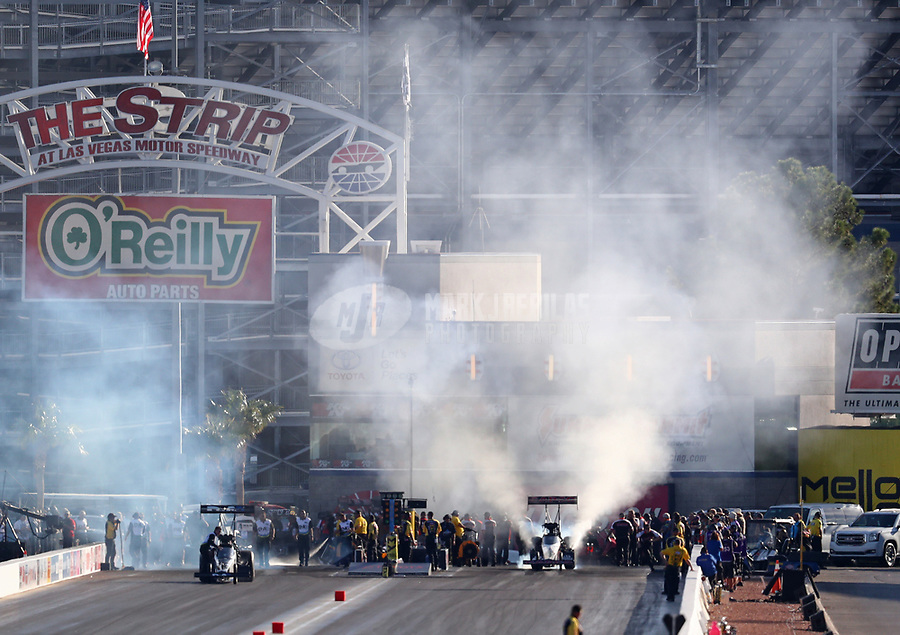 Oct 26, 2018; Las Vegas, NV, USA; Exhaust fumes rise as NHRA top fuel driver Billy Torrence does a burnout during qualifying for the Toyota Nationals at The Strip at Las Vegas Motor Speedway. Mandatory Credit: Mark J. Rebilas-USA TODAY Sports
