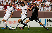 Real Madrid forward (20) Gonzalo Higuain drives into the box past  DC United defender (16) Greg Janicki during their friendly at FedEx Field in Landover, Maryland.  Real Madrid defeated DC United, 3-0.