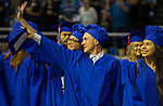 Robert Scott Matthew points out someone in the crowd to culinary school classmates during the TMCC Graduation held at Lawlor Events Center in Reno, Nevada on Friday, May 11, 2018.