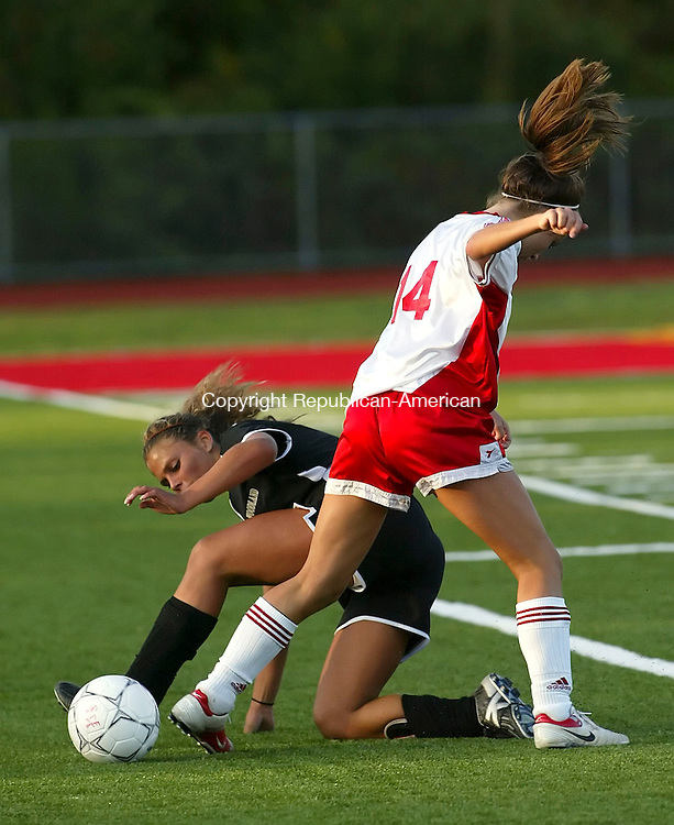 WOLCOTT, CT,12 SEPTEMBER 2006, 091206BZ07- Woodland's Alisha Berry (7) steals the ball from Wolcott's Kelsey Skura (14) during their game at Wolcott High School Tuesday.<br />  Jamison C. Bazinet Republican-American