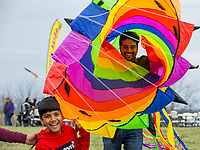 NWA Democrat-Gazette/BEN GOFF @NWABENGOFF<br /> Harish Nayak and son Surya Nayak, 7, of Bentonville goof around with a large wind sock Saturday, March 23, 2019, during the 29th annual Eureka Springs Kite Festival hosted by Turpentine Creek Wildlife Refuge in Eureka Springs. The free family event included kite making and kites for sale from Keleidokites in Eureka Springs and a variety of food trucks and entertainment. Strong wind kept dozens of kites flying high at any given time.