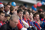 A Crystal Palace fan watches the action nervously at Hillsborough during his team's crucial last-day relegation match against Sheffield Wednesday. The match ended in a 2-2 draw which meant Wednesday were relegated to League 1. Crystal Palace remained in the Championship despite having been deducted 10 points for entering administration during the season.