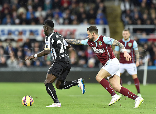 01.01.2015.  Newcastle, England. Barclays Premier League. Newcastle versus Burnley. Danny Ings of Burnley pulls back Cheick Tiote of Newcastle United