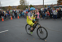 NWA Democrat-Gazette/ANDY SHUPE<br /> Jeff Lenosky, a professional mountain bicycle trials rider from Sparta Township, N.J., performs tricks Saturday, Nov. 11, 2017, during a celebration for Lewis and Clark Outfitters' newly expanded bike shop at the company's store in Fayetteville. Lenosky gave two shows, leaping over obstacles and even jumping into the bed of a full-size pickup truck.