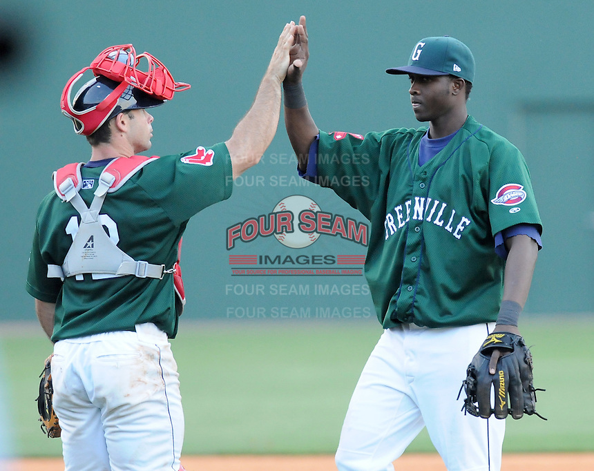 Greenville Drive shortstop Vladimir Frias (15) high-fives catcher Dan Butler (12) after beating the West Virginia Power 9-1 on May 2, 2010, at Fluor Field at the West End in Greenville, S.C. Photo by: Tom Priddy/Four Seam Images