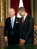 Washington, DC - January 20, 2009 -- United States President Barack Obama stands with Vice President Joseph Biden after Obama signed his first act as president, a proclamation, moments after being sworn in as the 44th President of the United States during the inaugural ceremony in Washington, Tuesday, January 20, 2009.   .Credit: Molly Riley - Pool via CNP