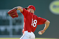 Starting pitcher Alex Scherff (18) of the Greenville Drive warms up before a game against the Charleston RiverDogs on Friday, April 27, 2018, at Fluor Field at the West End in Greenville, South Carolina. Greenville won, 5-4. (Tom Priddy/Four Seam Images)