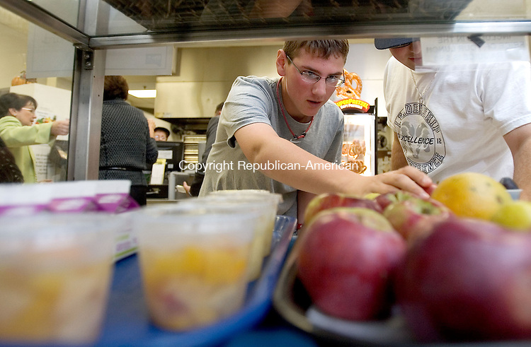 CHESHIRE, CT. 16 October 2012-101612SV05-Brenden Kennedy, 15, of Cheshire picks out a locally grown apple for lunch at Cheshire High in Cheshire Tuesday, The Connecticut Grown Campaign is moving into schools. Cheshire Public Schools will be serving locally grown food all week with a new initiative called Connecticut Grown for Connecticut Kids..Steven Valenti Republican-American
