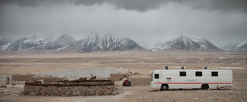 The camp of Kyrzyl Qorum with an abandoned bus..In and around the campment of Kyzyl Qorum, campment of the former deceased Khan, Abdul Rashid Khan..Trekking with yak caravan through the Little Pamir where the Afghan Kyrgyz community live all year, on the borders of China, Tajikistan and Pakistan.