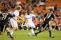 Khari Stephenson (7) of the San Jose Earthquakes passes the ball to teammate Steven Lenhart (24) during the game at RFK Stadium in Washington, DC.  D.C. United was defeated by the San Jose Earthquakes, 4-2.