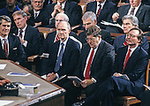 National Security Advisor Brent Scowcroft, center left, and White House Chief of Staff John Sununu, center right, look on as United States President George H.W. Bush delivers his State of the Union Address to a joint session of the United States Congress in the US Capitol in Washington, DC on January 31, 1990.  Also identifiable, in the second row, are US Senator Dan Coats (Republican of Indiana), far left, and US Senator John Warner (Republican of Virginia), far right.<br /> Credit: Ron Sachs / CNP