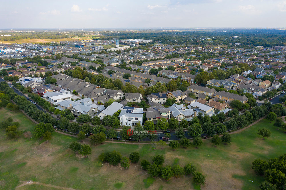 Mueller is located on the 711-acre site of the former Robert Mueller Municipal Airport. It has been open to new residents since 2007, the neighborhood is already home to many individuals and families. When fully built, Mueller will include over 5,700 homes with 13,000 residents, a town center with shops, including 30 percent locally-owned businesses, a major children's medical center and medical research complex, a film studio, rental properties, and top-tier office space. It will also include over 140 acres of parks and green space and 13 miles of new hike and bike paths.