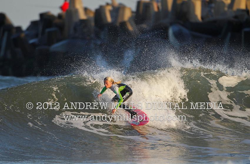 Kirsty Quigley Kamen surfs Manasquan Inlet