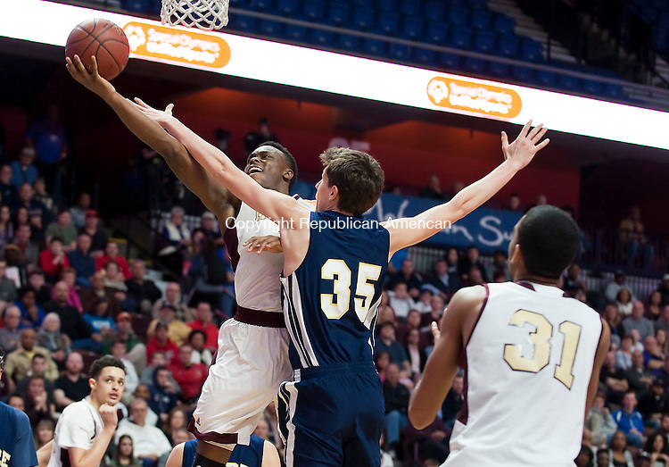 UNCASVILLE, CT--- -031916JS30-Sacred Heart's Mustapha Heron (3) lays in two of his game high 32 points in front of Notre Dame-Fairfield's Thomas Gerling (35) during their Class M  state championship game Saturday at Mohegan Sun Arena. <br /> Jim Shannon Republican-American