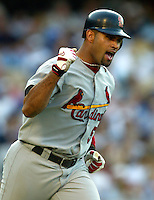 St. Louis Cardinals Albert Pujols pumps his arm after hitting the 100th homerun of his career In a MLB game played at Dodger Stadium where the St. Louis Cardinals beat the Los Angeles Dodgers 10-7