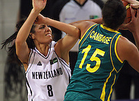 Opals forward Elizabeth Cambage muscles past Natalie Purcell during the International women's basketball match between NZ Tall Ferns and Australian Opals at Te Rauparaha Stadium, Porirua, Wellington, New Zealand on Monday 31 August 2009. Photo: Dave Lintott / lintottphoto.co.nz