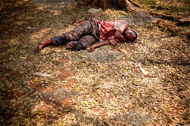 A man lies on the ground covered in his own blood. He was attacked by a Christian mob who accused him of being a member of the Seleka and although peacekeepers saved him he died from his wounds. In 2013 a rebellion by a predominantly Muslim rebel group Seleka, led by Michel Djotodia, toppled the government of President Francios Bozize. Djotodia declared that Seleka would be disbanded but as law and order collapsed the ex-Seleka fighters roamed the country committing atrocities against the civilian population. In response a vigillante group, calling themselves Anti-Balaka (Anti-Machete), sought to defend their lives and property but they then began to take reprisals against the Muslim population and the conflict became increasingly sectarian. French and Chadian peacekeeping forces have struggled to contain the situation and the smaller Muslim population began to flee the country.